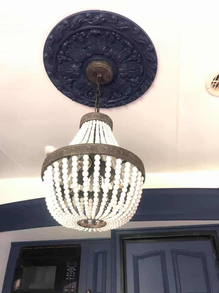 light fixture looks amazing with the medallion. How to remodel an RV pretty colorful (Boho Style)