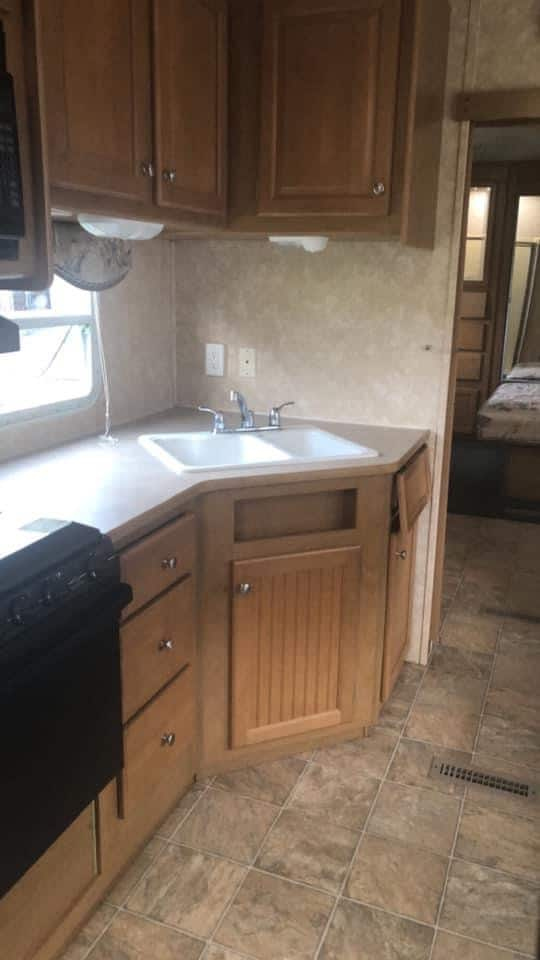 Camper kitchen in brown and beige. How to update a Camper easy with the right textiles 3 quick and easy remodel tips to make your RV cozy