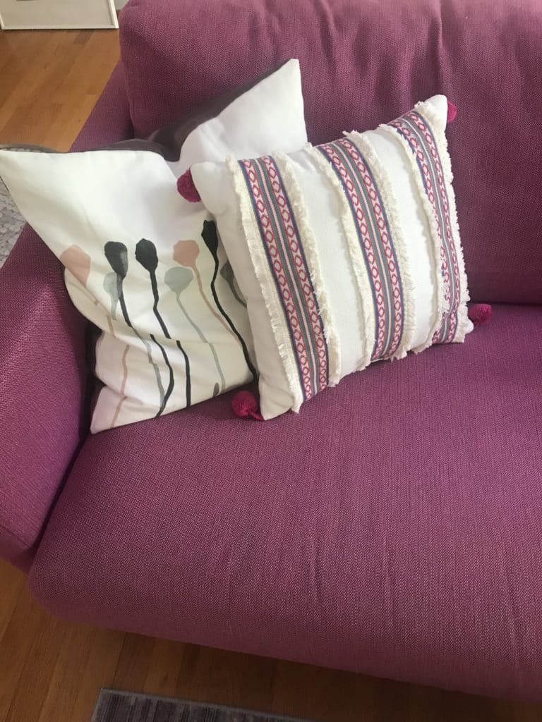 pink couch with pillows