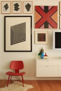 display art in your living room wall with different sized pictures.