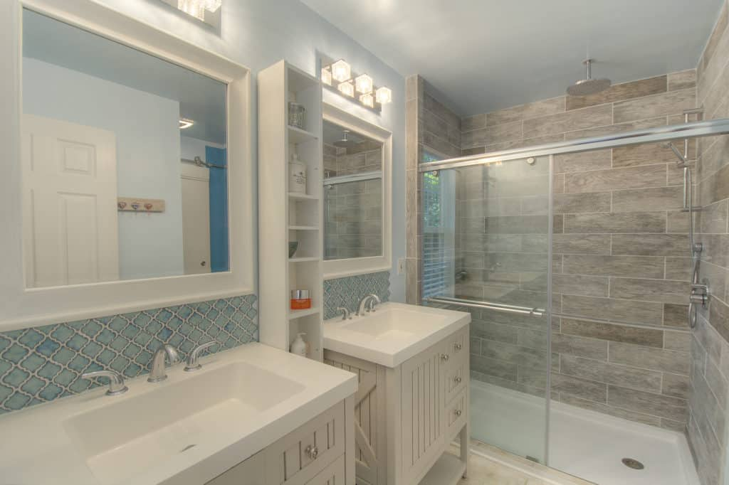 Completely renovated bathroom in a rustic but muted style. Top 3 Home updates before selling.