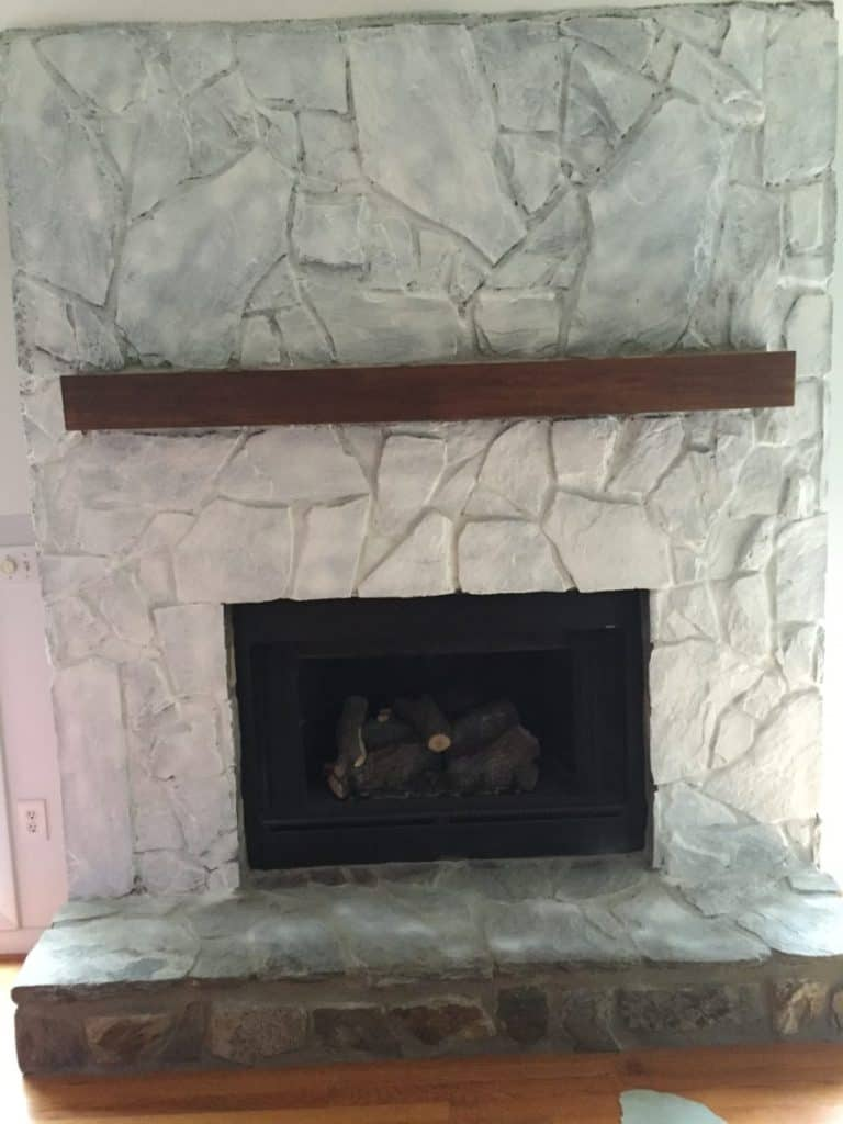 How to paint a brick fireplace, 1 coat of paint