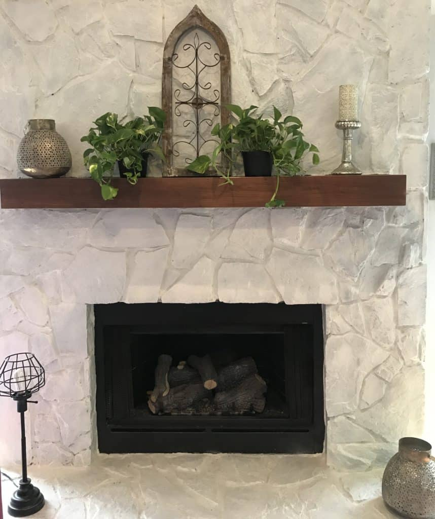 fireplace mantel decorated with rustic decor