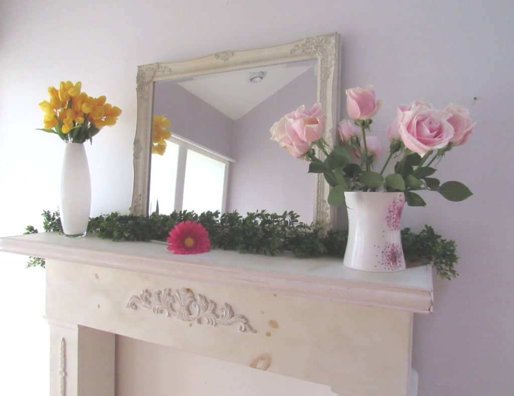 decorate a fireplace mantel with fresh flowers