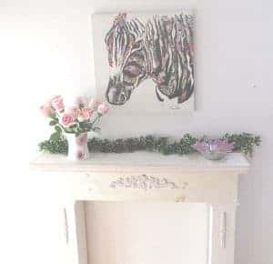 Decorated mantel piece to add a focal point.