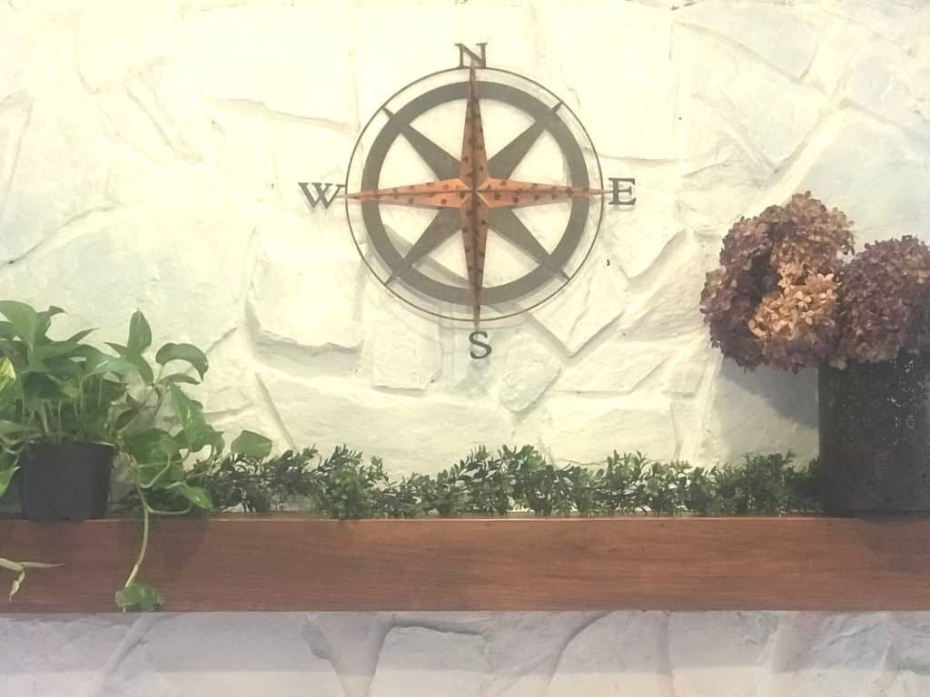 decorate a fireplace mantel with plants