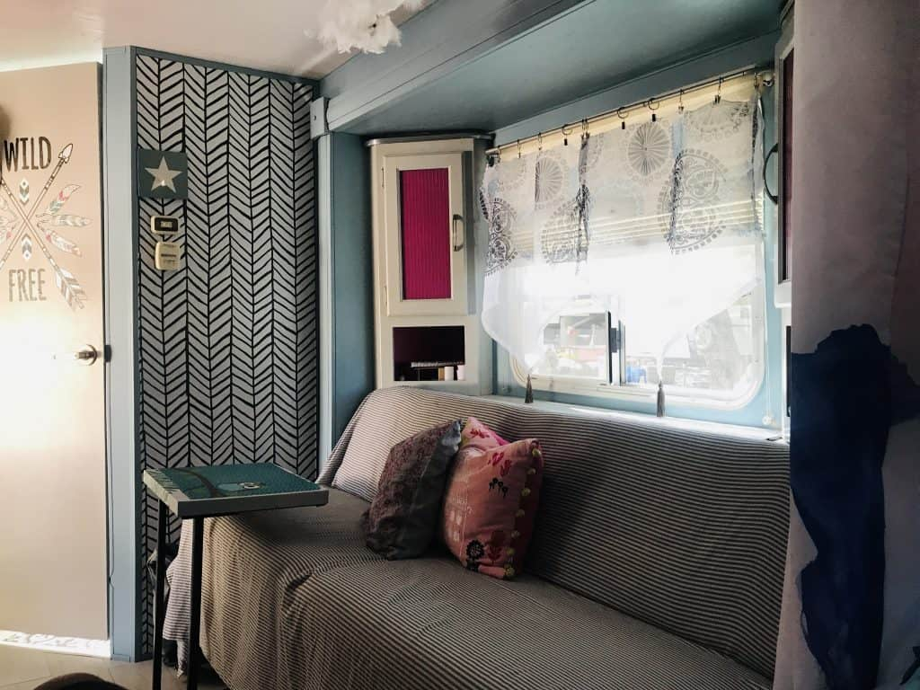 updated Camper in fresh colors and a new curtain. How to update a Camper easy with the right textiles 3 quick and easy remodel tips to make your RV cozy