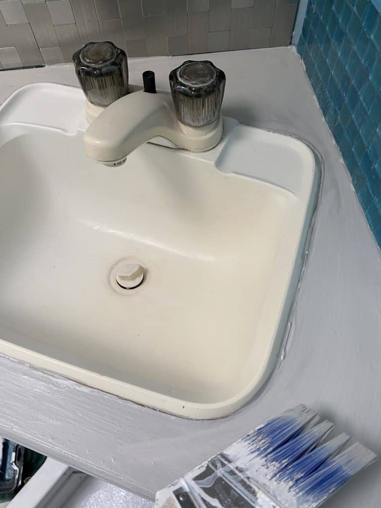 Yellow sink before spray painting. 5 affordable RV updates you can easily do on your own