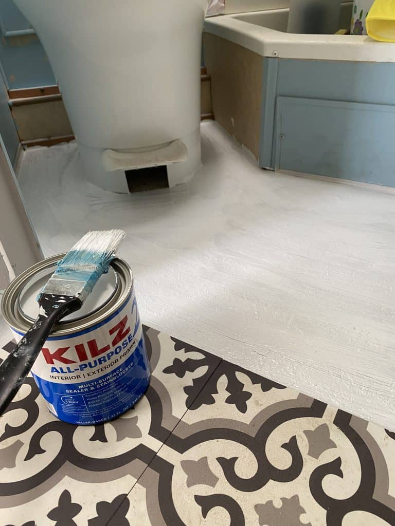 prime the RV bathroom floor with Kilz primer, then add the porch paint.