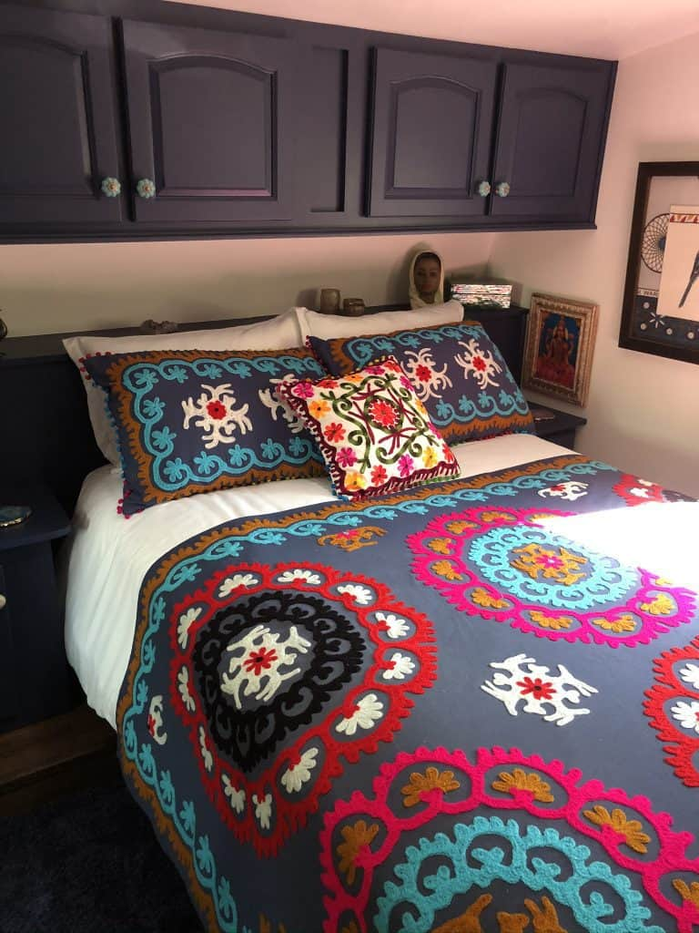 Bedroom with colorful throw - where it all began. How to remodel an RV pretty colorful (Boho Style)