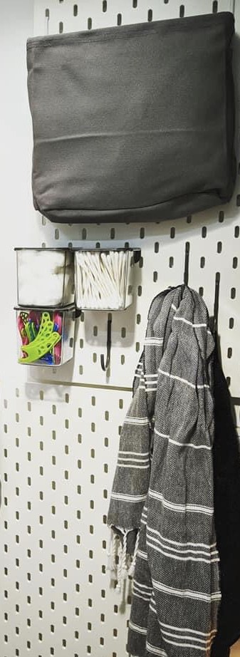 Pegboard if you want to organize stuff with hooks- 7 Best ways to hang wall decor easy in an RV or rental place