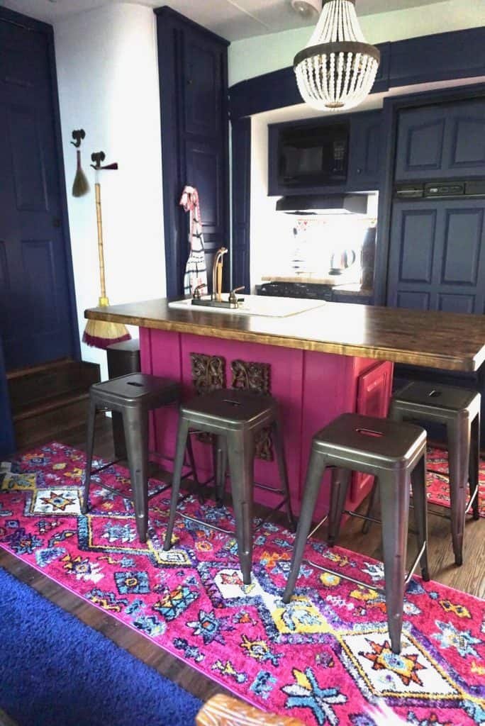 kitchen bar in magenta with a big butcher block