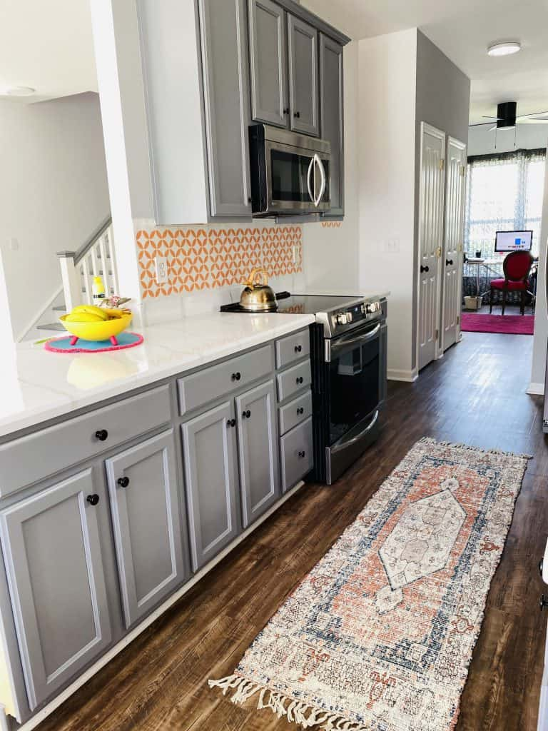 updated kitchen with stencil and rug