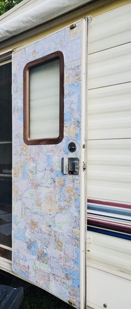 map decoupage on front door