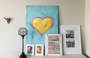 Wall art layered on a dresser