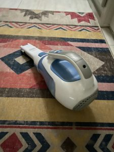 A small vacuum cleaner is a big help fighting against dirt and dog hair