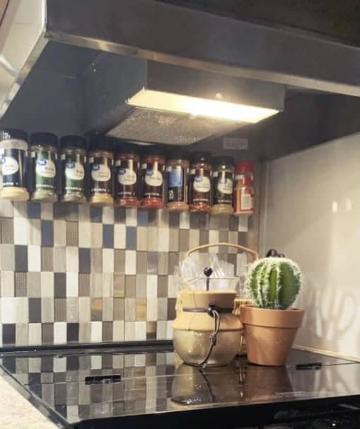 A hanging spice rack saves a lot of space in an RV.
