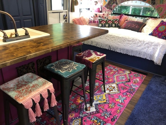 pink, blue and white RV interior with a pink runner. How to update a Camper easy with the right textiles