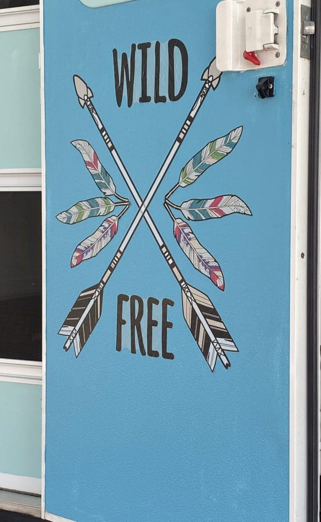 Painted  RV door in a pretty blue and added a decal