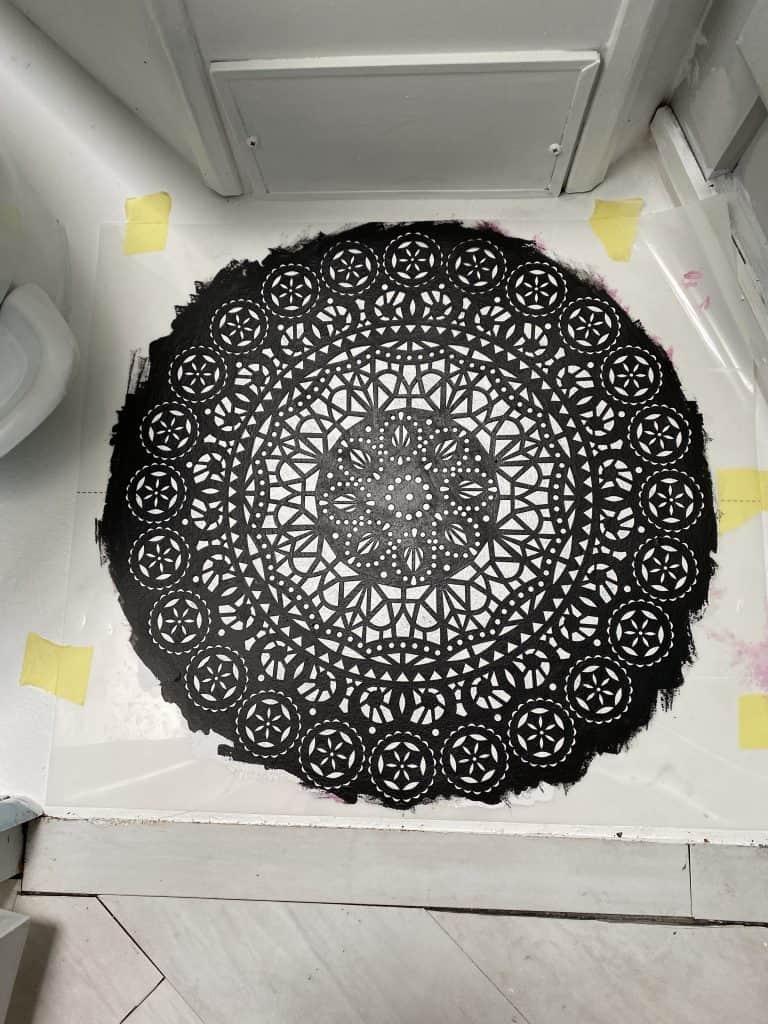 Painted RV bathroom floor with a stencil