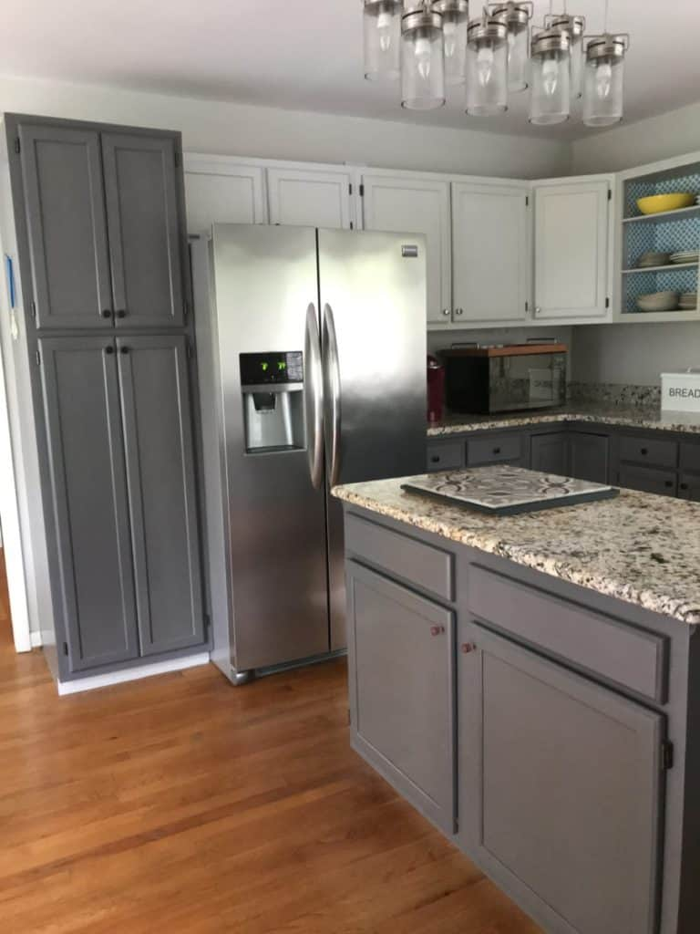 Kitchen cabinets painted in light and dark grey