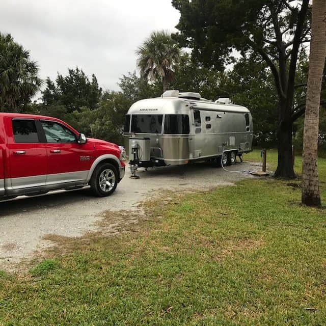 Nice sites at Edisto Beach State Campground below Palm trees and enough space for a comfortable hook up.