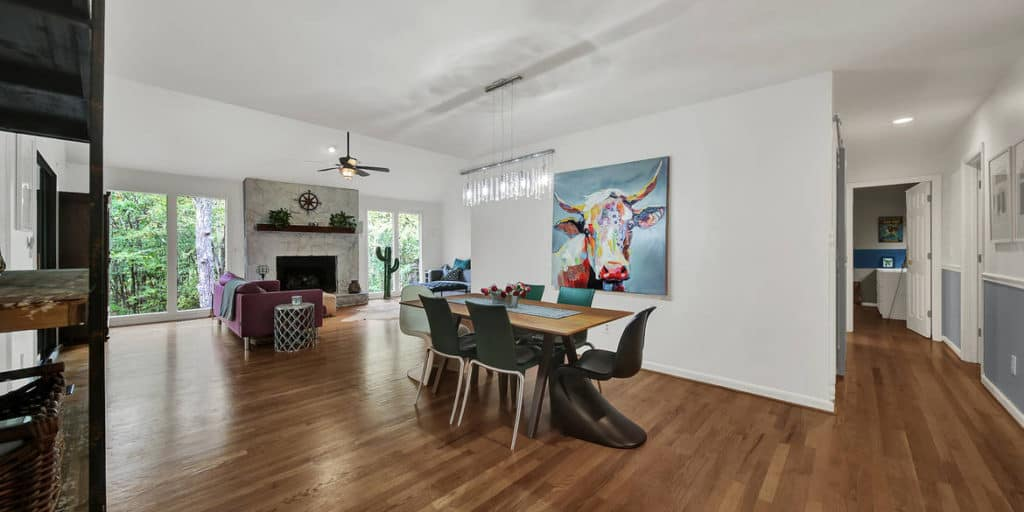 Artwork in the dining room rooms flow together