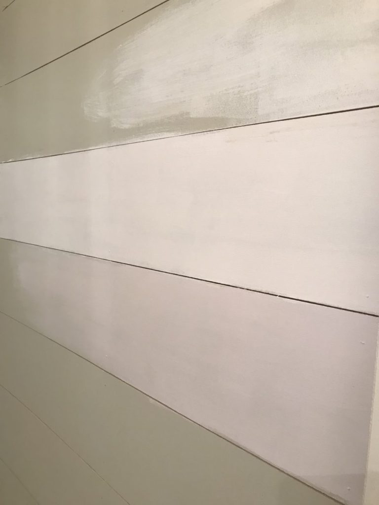 Start priming the plywood boards.