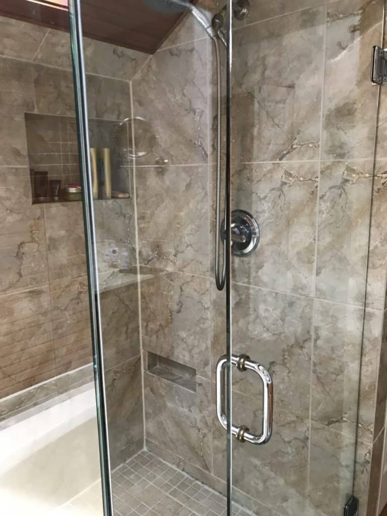 Shower door sparkles after cleaning the easy way. How to clean windows with best results.