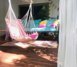 hanging chair and daybed look great on a patio