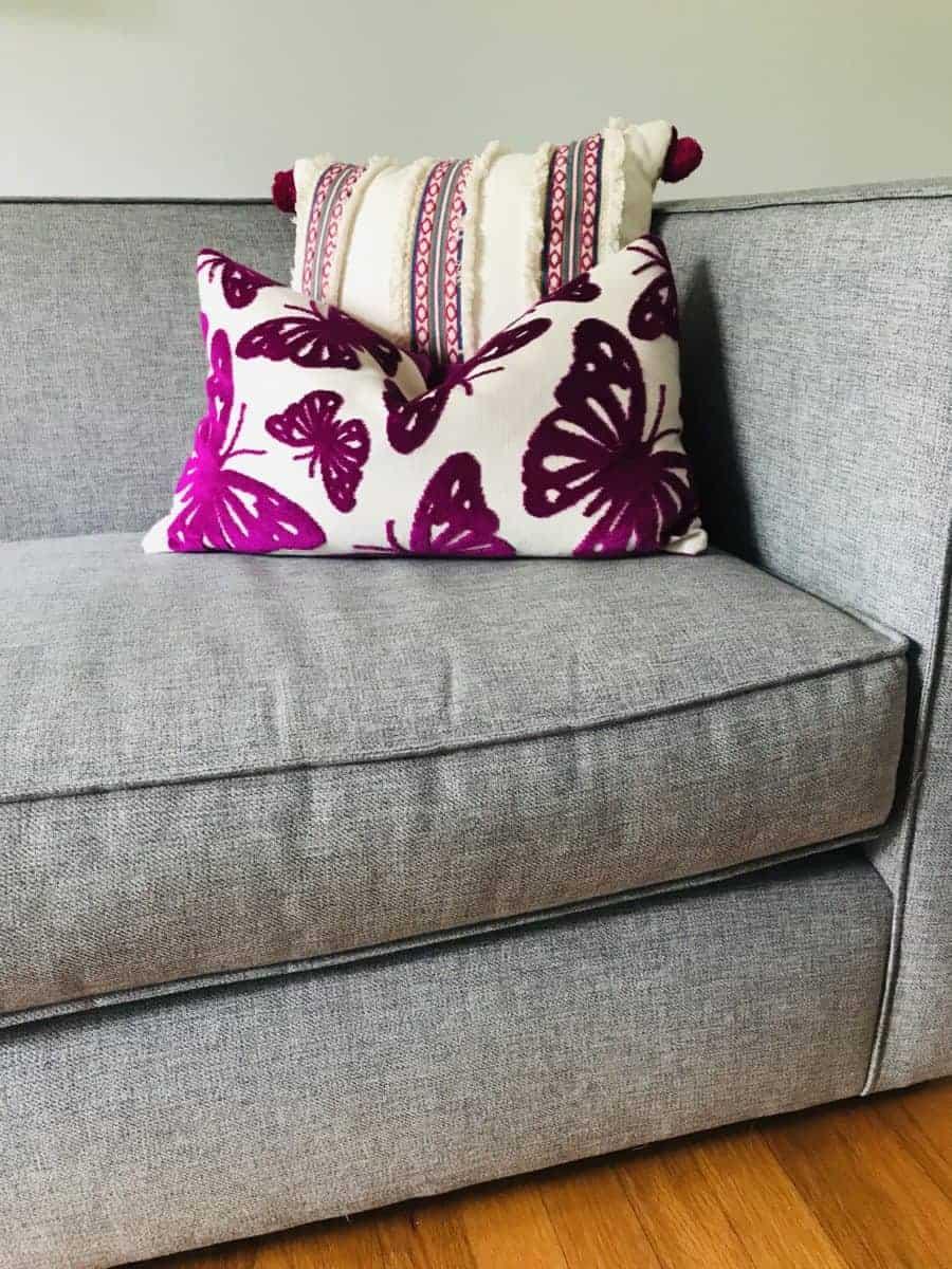 pink pillows on gray sofa