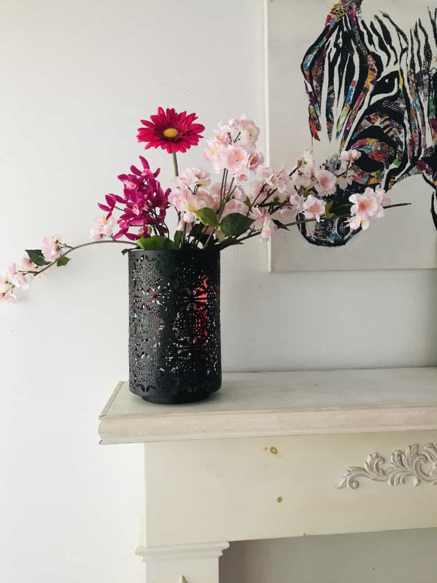 Pink flowers on mantel