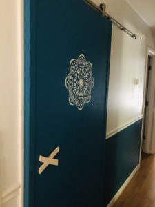Blue barn door with white stencil