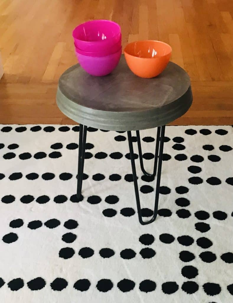 cute little side table with bowls