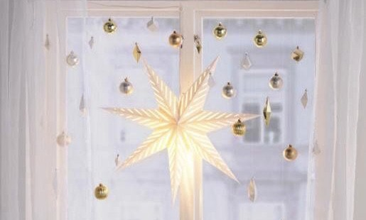 window decoration with star and ornaments.