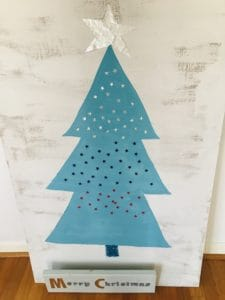 Christmas tree painted on plywood