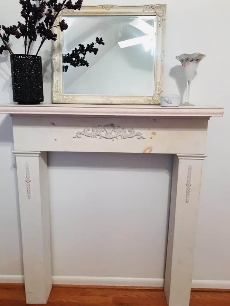 White fireplace mantel with mirror