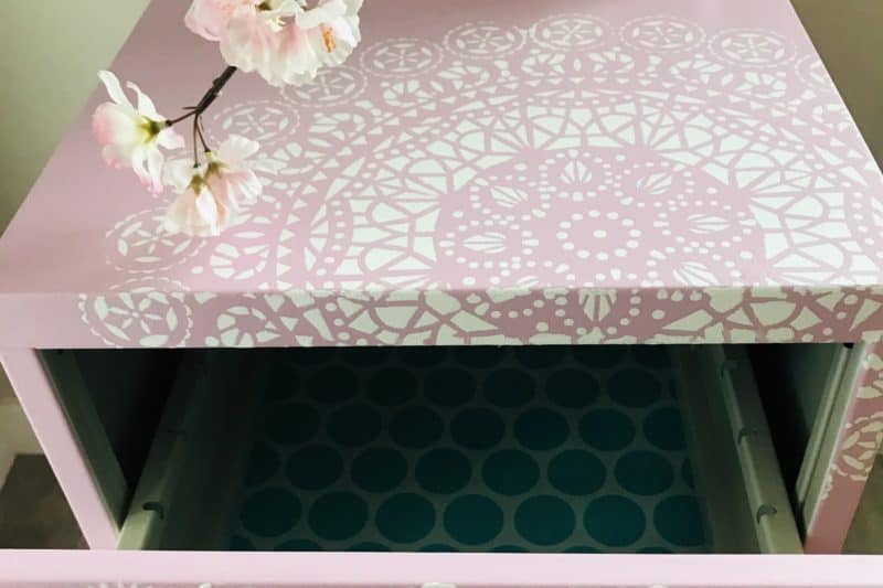 finished metal cabinet painted in light rose and stencil added