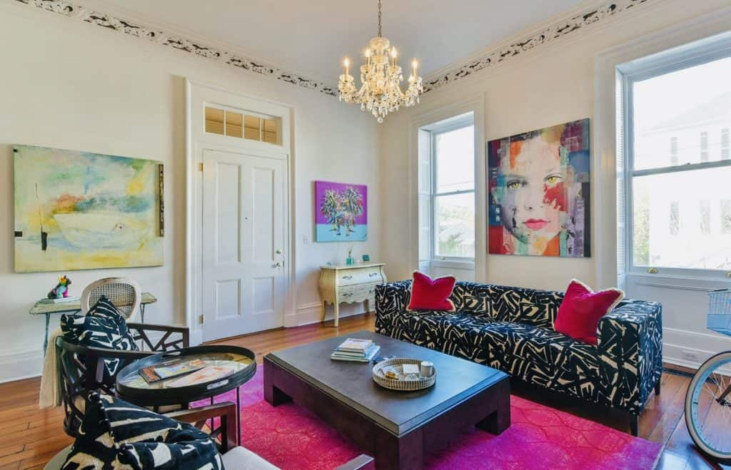 colorful living room with rug, artwork and pillows