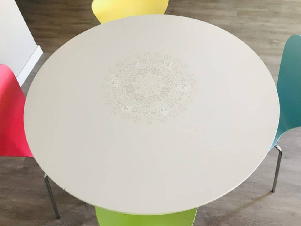 white kitchen table with white stencil. The ultimate tips how to easily add stencils on furniture
