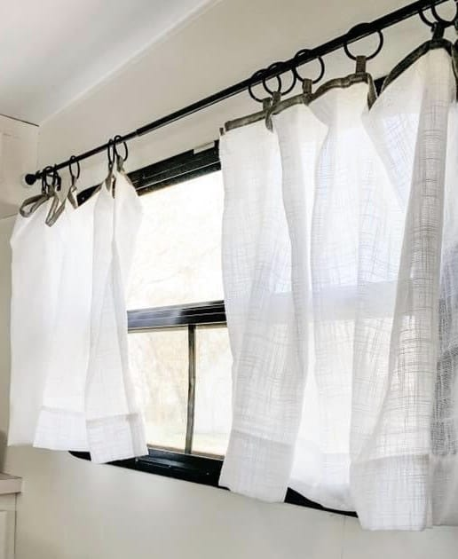 pretty curtains for more light in your camper
