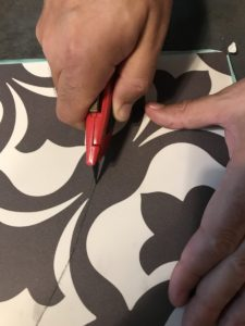 use a carpet knife to cut the vinyl tiles