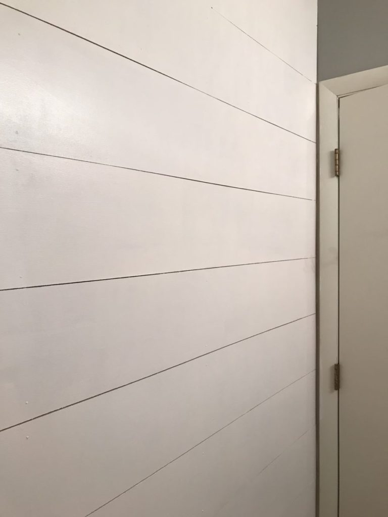Painted shiplap wall