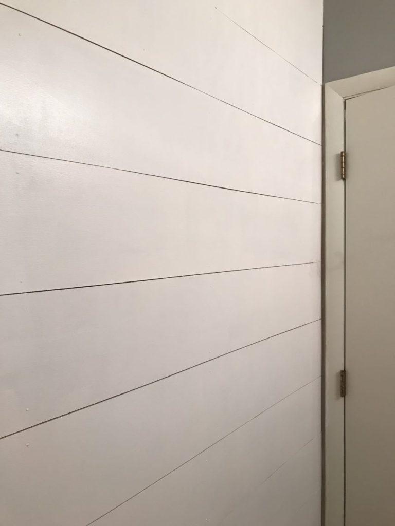 Painted shiplap wall in bathroom remodel