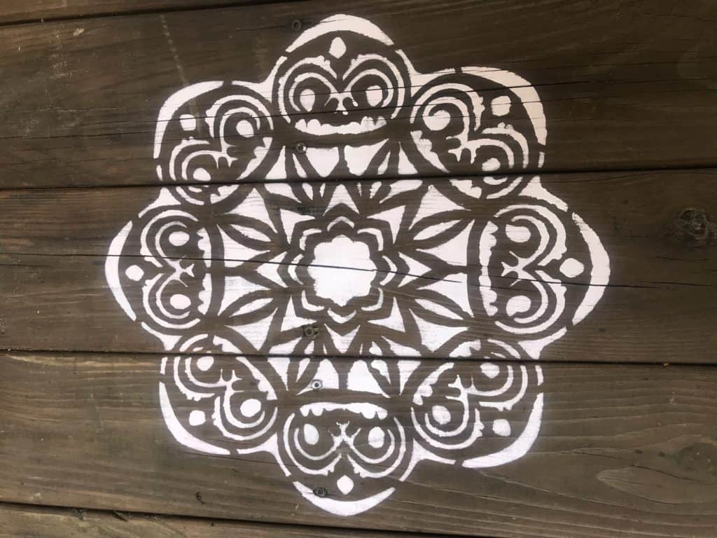 Love to add stencils on my deck. See what I used to paint this stencil on wood.